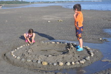 Kids building fish trap